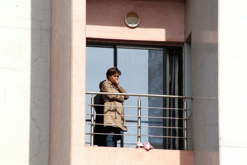 A hostage waits on a balcony for rescue at the Radisson Blu hotel, Bamako, Mali, Nov. 20, 2015. Three Chinese citizens were killed in a hostage-taking situation at ...