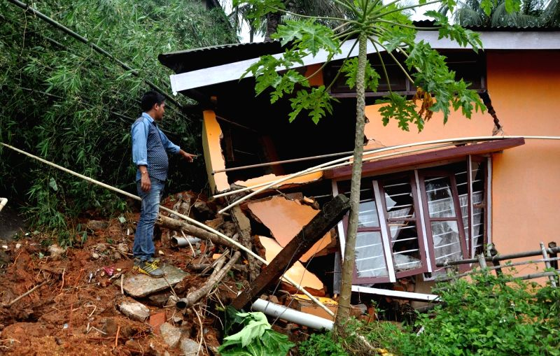 A house collapses due to landslide caused by incessant rains in Guwahati, on June 14, 2017.