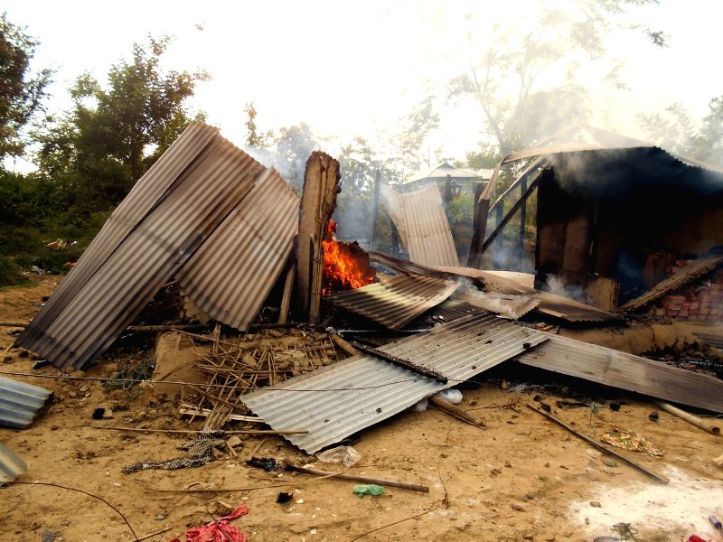 A house set on fire after people of  two communities clashed in North Tripura May 15, 2016.