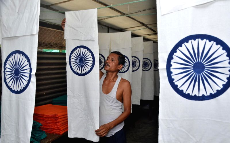 A Khadi Gram Udyog worker busy making the tricolour ahead of Independence Day in Guwahati on Aug 7, 2018.