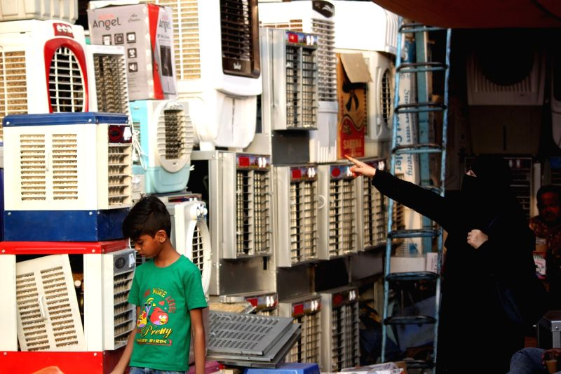 A lady busy looking for air coolers at a shop after Thursday's maximum temperature settled at 43.2 degrees Celsius, five notches above the season's average, while minimum temperature was ...