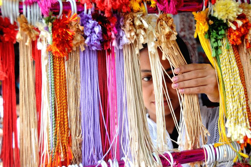 A lady busy shopping ahead of `Raksha Bandhan`in Bangalore on Aug 6, 2014.