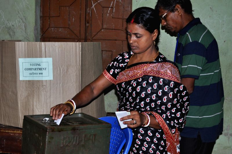 A lady casts her vote during Panchayat Elections in Durjoynagar of West Tripura on July 15, 2014.
