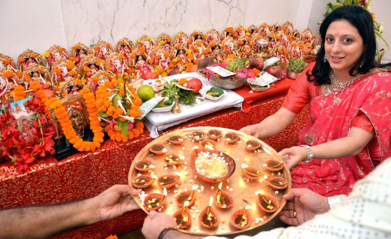A lady celebrates Diwali