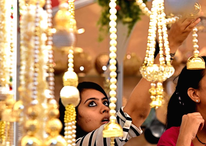A lady looks at ornaments displayed at a jewellery exhibition in Chennai on Aug 26, 2014.