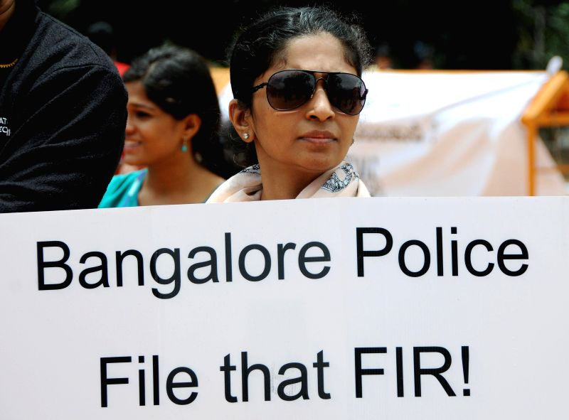 A lady  participates in a demonstration against  crime against women in Bangalore on July 20, 2014.