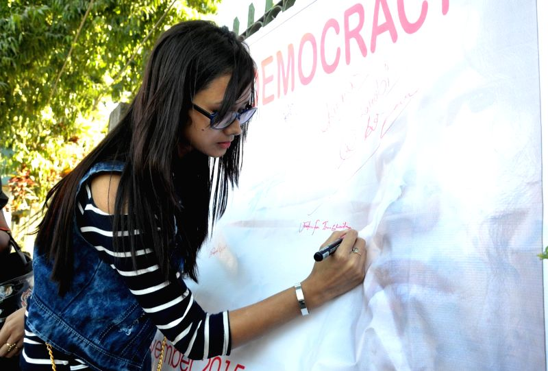 A lady participates in a signature campaign to show solidarity with Irom Chanu Sharmila in Guwahati, on Nov 2, 2015.