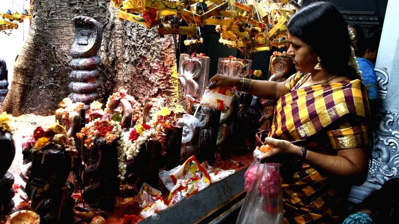 A lady pours milk over a diety during  Aadi celebrations at Mundakanni Amman temple in Chennai, on Aug 5, 2016.