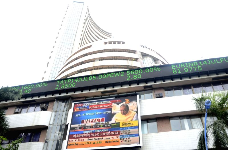 A large screen outside Bombay Stock Exchange displays live telecast of Union Finance minister Arun Jaitley's Budget speech in the Parliament, in Mumbai on July 10, 2014. - Arun Jaitley