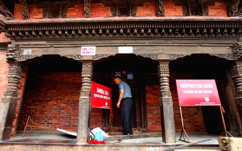 A local man offers prayers at a temple on the hundred days after the devastating earthquake at Mangalbazar in Lalitpur, Nepal, Aug. 2, 2015. The Nepalese government ...