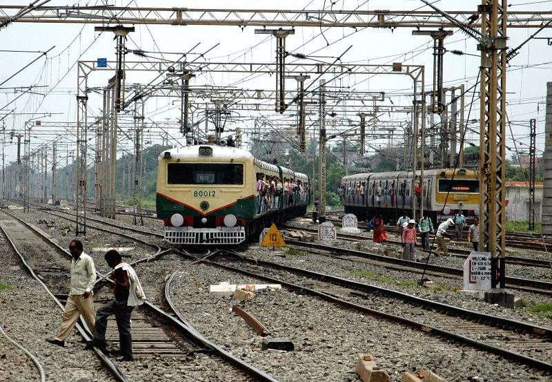 A local train arrives at platform of Dum Dum Station in Kolkata on July 8, 2014.