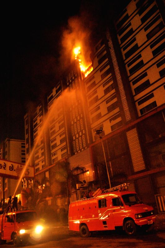 A major fire breaks out in the Landmark Empire building in Saroli area of Surat around 6 pm on April 23, 2014. The building houses one of the biggest textile markets of the city.