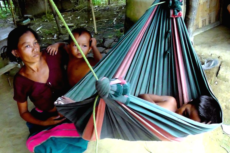 A malaria infected tribal family in Gandacherra of Tripura on July 18, 2014.