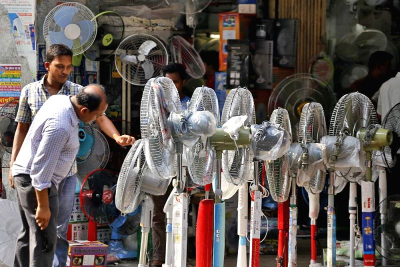 A man at a shop selling fans in Stadium Market during summers in Dhaka, Bangladesh on April 25, 2014.