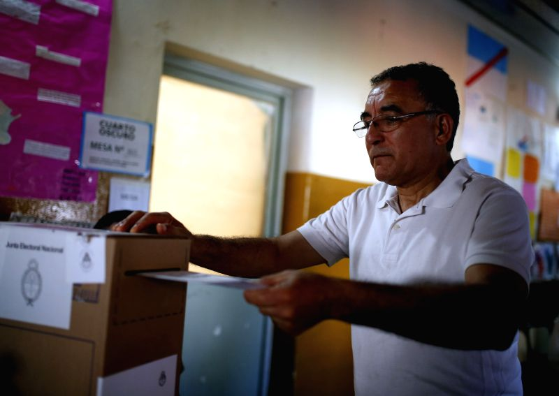 A man casts his ballot in a polling station at a school in Dique Lujan town, 50km from Buenos Aires, Argentina, on Nov. 22, 2015. The ruling Front for Victory ...