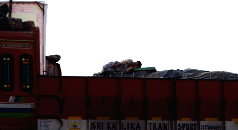 A man enjoys his siesta atop a truck in Chennai on May 11, 2017.