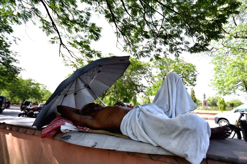 A man enjoys his siesta on a hot day in Jaipur on June 5, 2017.