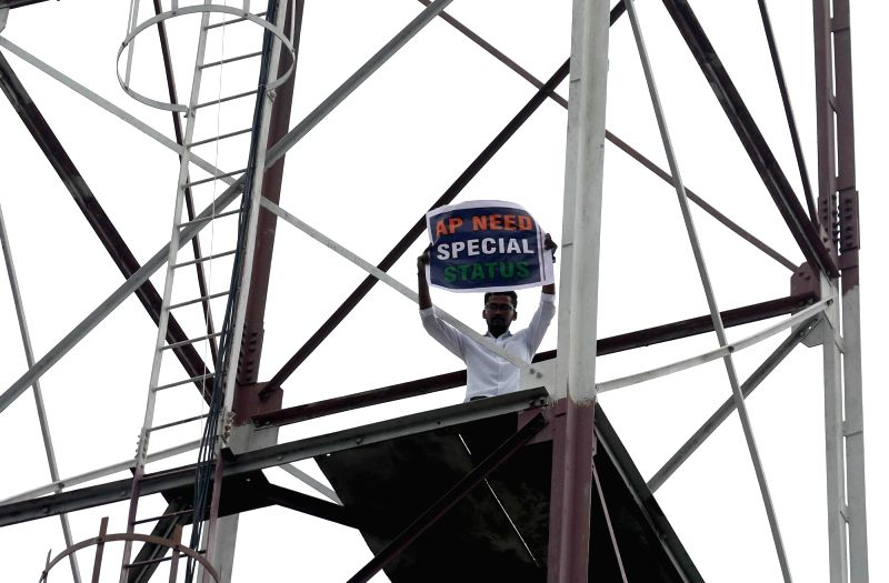 A man identified as Umesh Reddy from Warangal climbs on top of a cell phone signal transmission tower, threatening to commit suicide if Andhra Pradesh is not awarded Special Status ... - Umesh Reddy