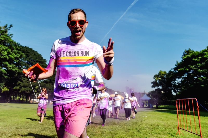 A man participates in the Color Run Bangkok at the Suan Rod Fai park in Bangkok, Thailand, Oct. 31, 2015. The Color Run is a 5km public paint race that originated ...