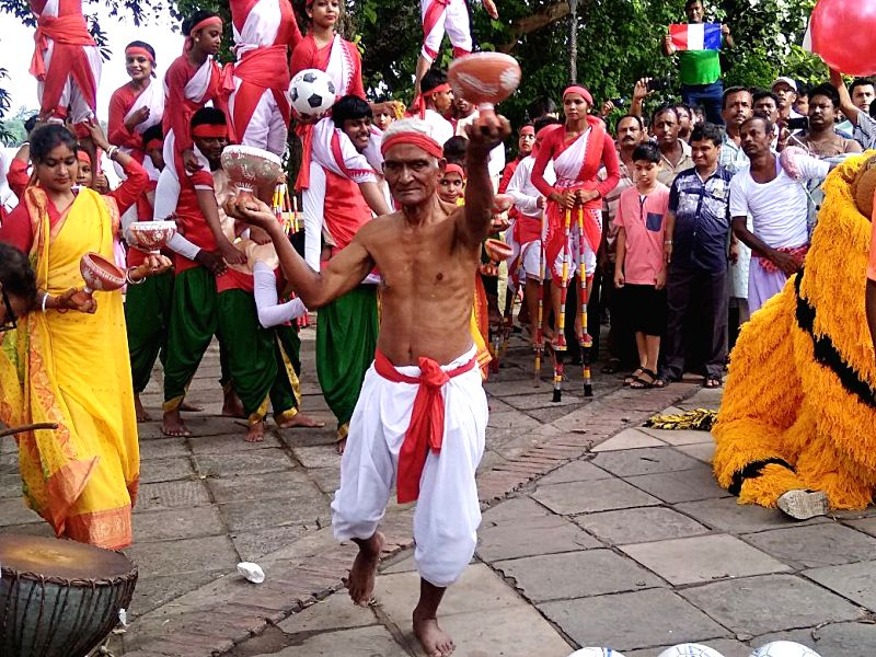 "A man performs ""Dhunuchi Dance"" ahead of FIFA World Cup final between France and Croatia in West Bengal's Chandannagar - former French colony - on July 15, 2018."