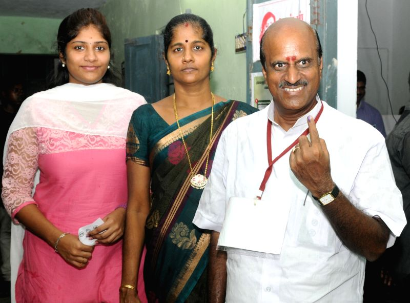 A man shows his forefinger marked with phosphorous ink after casting vote, at a polling booth, during the Puducherry Assembly Election, on May 16, 2016.