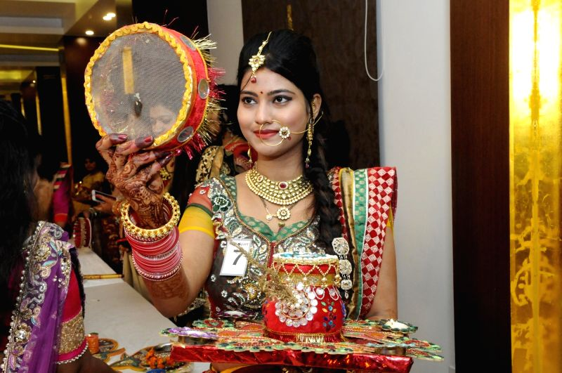 A married woman celebrates Karwa Chauth in Lucknow on Oct 30, 2015.
