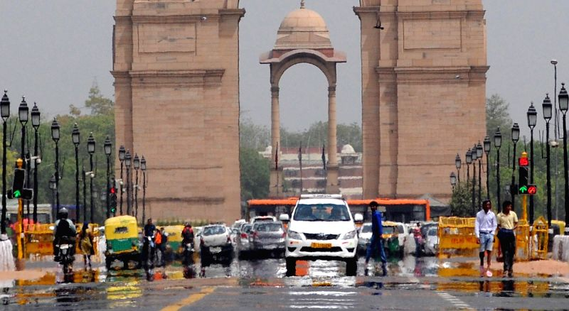 A mirage appears on Rajpath on a hot afternoon in New Delhi on April 4, 2016.