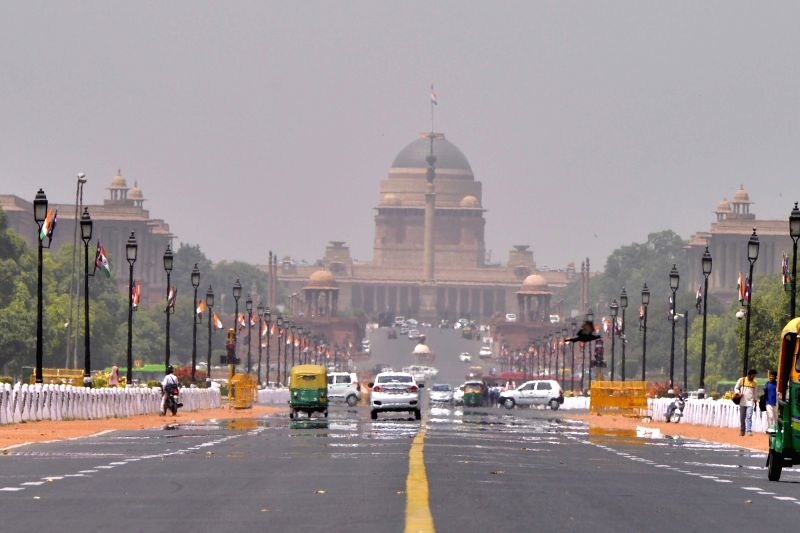 A mirage appears on the Rajpath on a hot day in New Delhi on April 20, 2017.