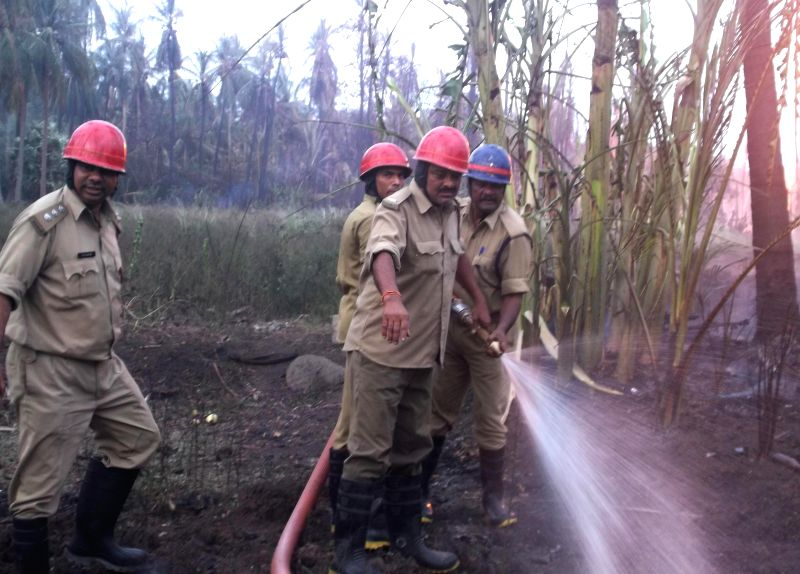 (A mobile camera photo) Firemen try hard to douse a fire that broke out after a blast in a gas pipeline belonging to GAIL in Andhra Pradesh's East Godavari district on June 27, 2014.