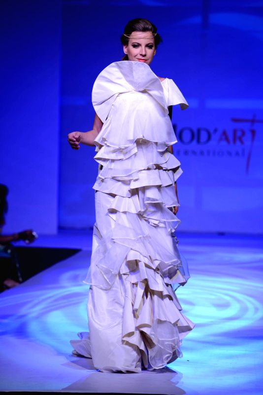A model displays creation of students during Mod`Art International`s annual graduating event Mumbai on May 13, 2014.