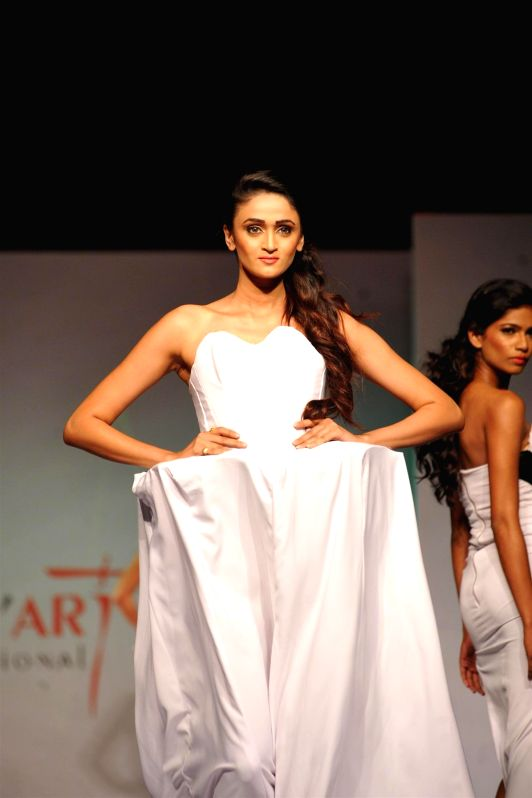 A model displays creation of students during Mod`Art International`s annual graduating event in Mumbai on May 13, 2014.