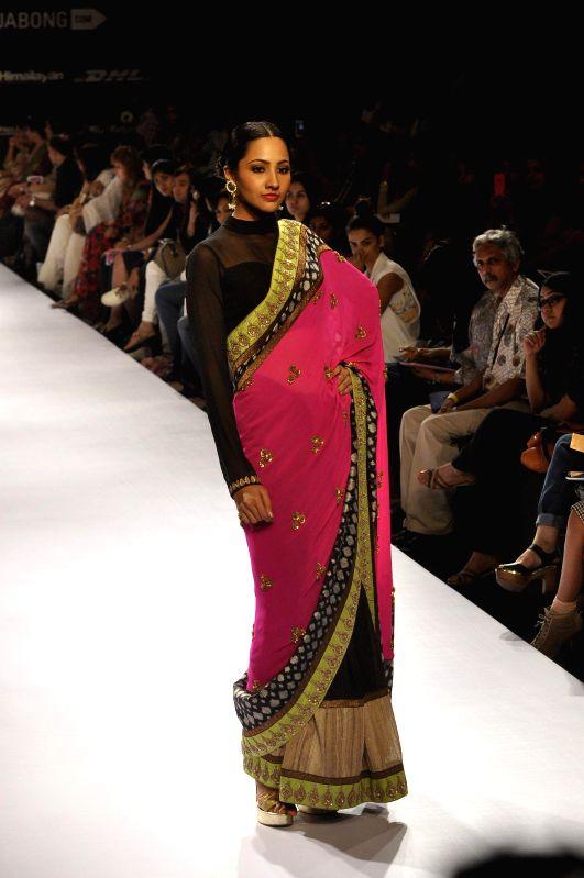 A model displays the creation of fashion designers Ekta Jaipuria and Ruchira Kandhari during the Lakme Fashion Week (LFW) Winter/ Festive 2014, in Mumbai, on Aug. 22, 2014.