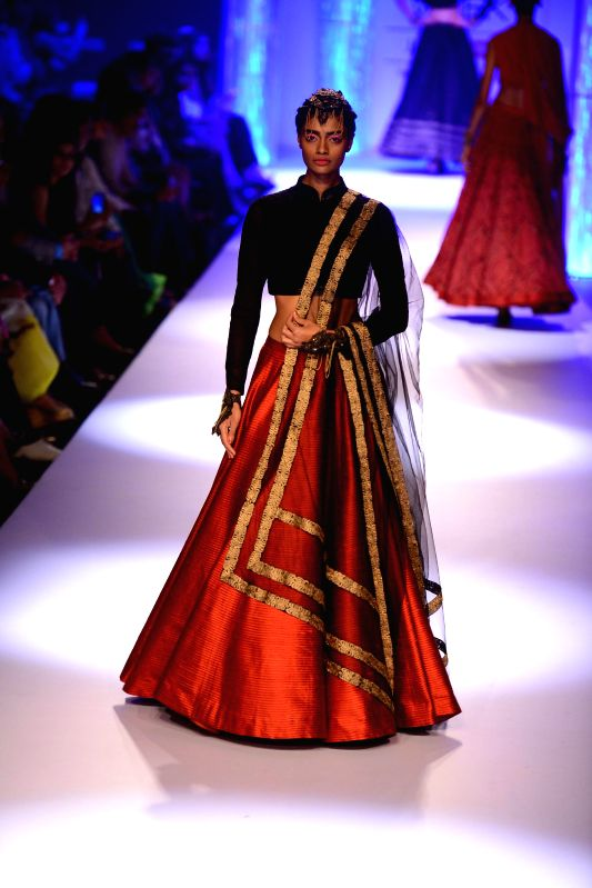 A model displays the creation of fashion designers Shantanu & Nikhil during the Lakme Fashion Week (LFW) Winter/ Festive 2014 in Mumbai, on Aug. 23, 2014.