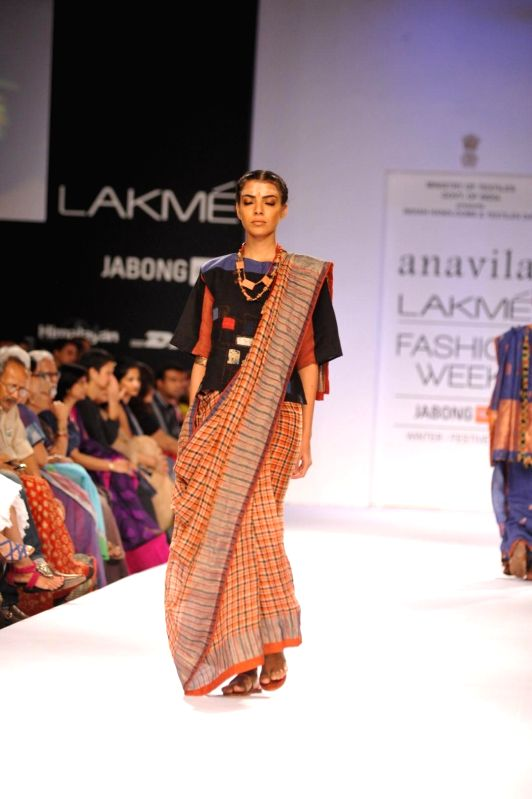 A model displays the creation of fashion designer Anavila during the Lakme Fashion Week (LFW) Winter/ Festive 2014 in Mumbai, on Aug. 21, 2014.