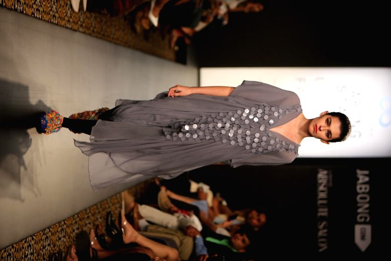 A model displays the creation of fashion designer Anuj Sharma during the Lakme Fashion Week (LFW) Winter/ Festive 2014 in Mumbai, on Aug. 21, 2014.
