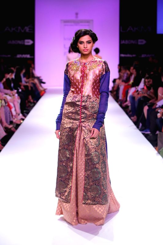 A model displays the creation of fashion designer Krishna Mehta during the Lakme Fashion Week (LFW) Winter/ Festive 2014 in Mumbai, on Aug. 21, 2014.