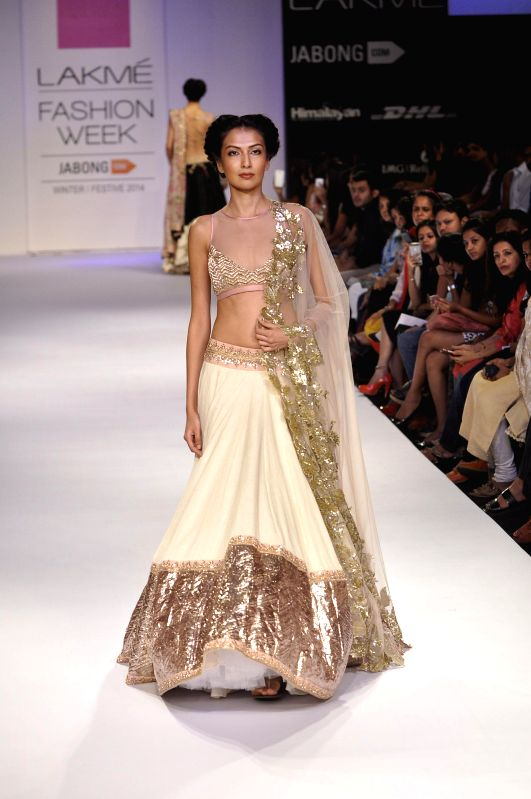 A model displays the creation of fashion designer Anushree Reedy during the Lakme Fashion Week (LFW) Winter/ Festive 2014 in Mumbai, on Aug. 23, 2014.