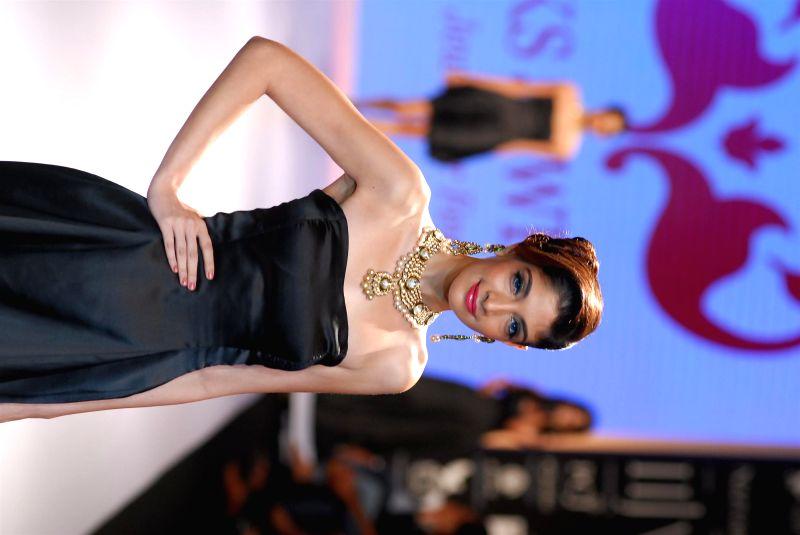 A model displays the jewellery by designer Alka Kumar during the India International Jewellery Week (IIJW) in Mumbai, on July 15, 2014.