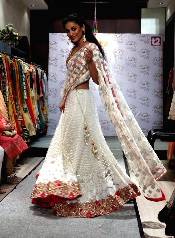 A model during a fashion show organised on the fourth anniversary of a renowned ethnic brand showroom in Kolkata on July 3, 2014.