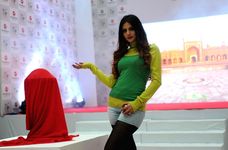 A model during a programme organised to unveil the ICC World Cup at in New Delhi, on Dec 5, 2014.