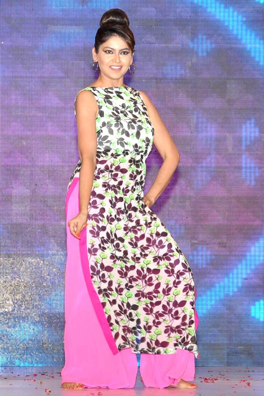 A model during 'Festival of Hope' - a fashion show organised by Indian Cancer Society and DLF in Gurgaon on May 18, 2014.