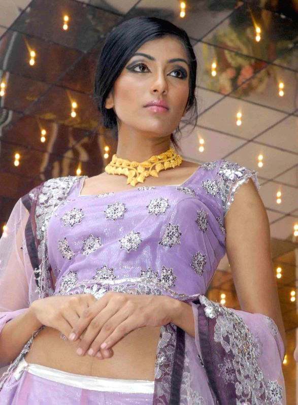 A model during inauguration of a jewellery showroom in Bangalore on June 29, 2014.