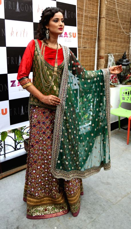 A model during launch of `Kriti` in Kolkata on Aug 21, 2014.