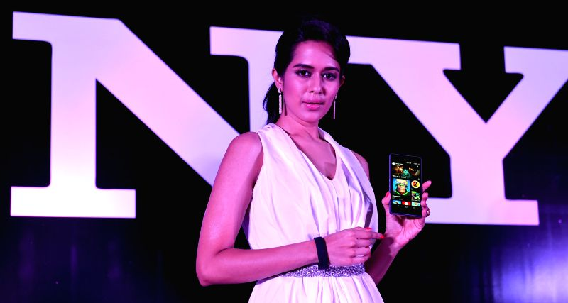 A model launches Sony new phone in Chennai on May 13, 2014.