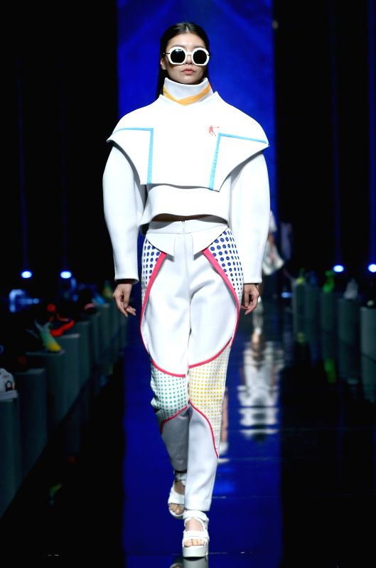 A model presents a creation at the Qiaodan Cup China Sports Wear Design  Contest during the China Fashion Week in Beijing, capital of China, Oct. 28, 2015.  ...