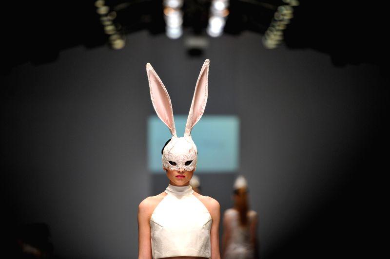A model presents a creation by Indonesian designer Bramanta Wijaya on the Jakarta Fashion Week 2016 in Jakarta, Indonesia, Oct. 28, 2015.