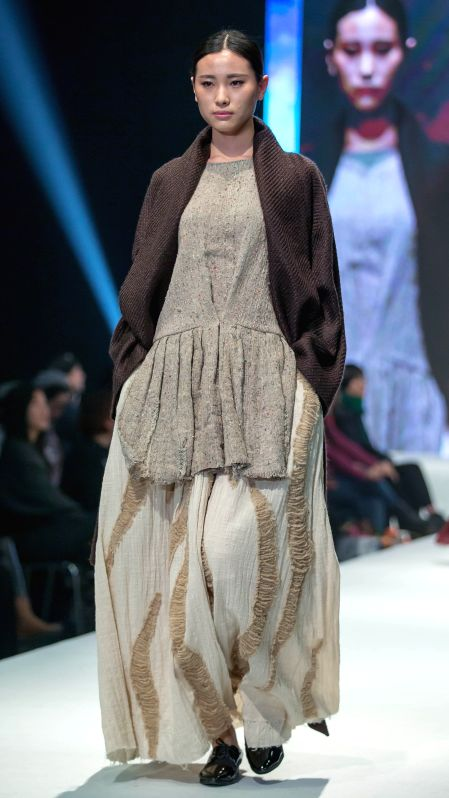 A model presents a creation designed by graduates of Beijing Institute of Fashion Technology at a fashion show in Beijing, capital of China, Dec. 1, 2015. (Xinhua/Li ...