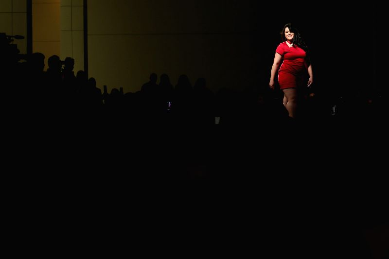 A model presents a creation during the runway show of the summer collection of the 12th Fashion Weekend Plus Size, in Sao Paulo, Brazil, on July 25, 2015. ...