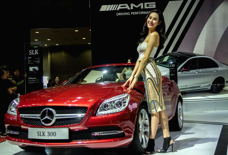 A model presents a Mercedes-Benz SLK300 during the Vietnam Motor Show 2015 at Saigon Exhibition and Convention Centre in Ho Chi Minh city, Vietnam, Oct. ...