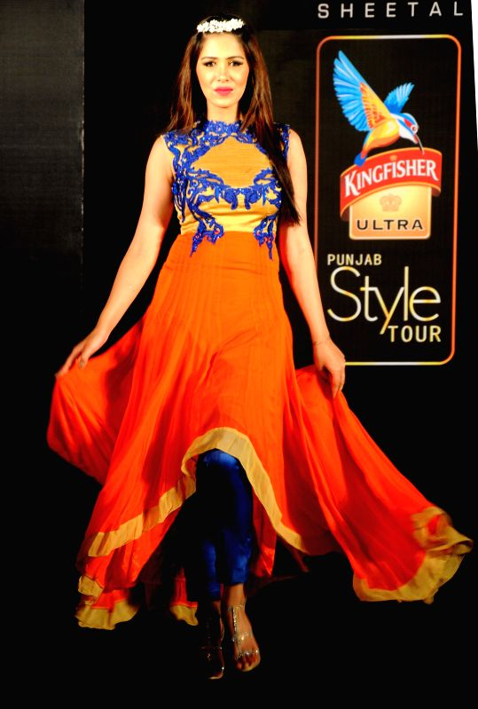 A model showcases fashion designer Jattinn Kochhar and Sheetal Lyall's creation during Kingfisher Ultra Punjab Style Tour in Amritsar on Aug 2, 2014.